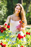 Female florist in summer garden Royalty Free Stock Photos