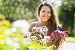Female florist in summer garden Stock Photography