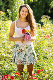 Female florist in summer garden Royalty Free Stock Photography