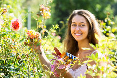 Female florist in summer garden Royalty Free Stock Images