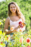 Female florist in summer garden Stock Photos