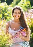Female florist in summer garden Stock Images