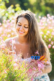 Female florist in summer garden Royalty Free Stock Photos