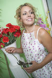 Female Florist Trimming Flowers Stock Photos