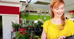 Female florist using credit card terminal stock video