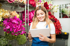 Female florist using a tablet for work Royalty Free Stock Photography