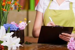 Female florist at work. Royalty Free Stock Image