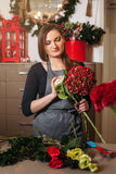Female florist working with flowers Royalty Free Stock Images