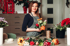 Female florist working with flowers Stock Photography