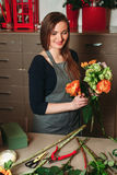 Female florist working with flowers Stock Photo