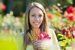 Female florist working in garden Royalty Free Stock Photos