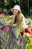 Female florist working in garden Royalty Free Stock Image