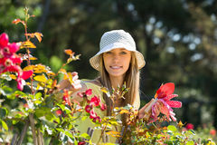 Female florist working in garden Stock Image