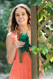 Female florist working in the garden Stock Image