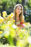 Female florist working in garden Royalty Free Stock Images