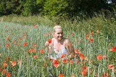 Female in Flower Meadow Stock Photo