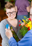 Female Flower Shop  Customer Paying with Credit Card Royalty Free Stock Photo