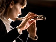 Female flutist performing Royalty Free Stock Photo