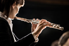 Female flutist performing Royalty Free Stock Image