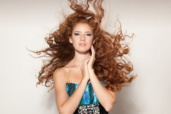 Female with fluttering in the wind hair Royalty Free Stock Images