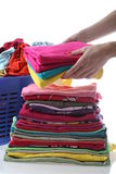 Female folds laundry Stock Photo