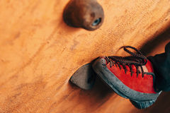 Female foot on climbing wall Stock Images