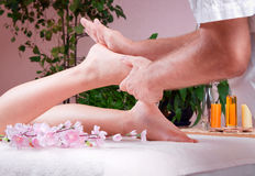 Female foot massage Stock Images