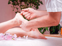 Female foot massage Stock Photo