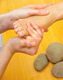Female foot on massage spa treatment Royalty Free Stock Photos