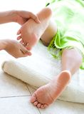 Female foot reflexology in spa Royalty Free Stock Photo