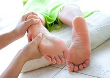Female foot reflexology in spa Royalty Free Stock Image