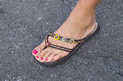 Female foot with sandal with beads Royalty Free Stock Photo