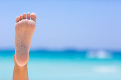 Female foot on sea background. Female foot on blue sky and sea background stock images