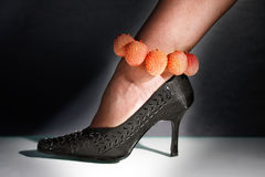 Female foot in a shoe on a high heel Stock Photo