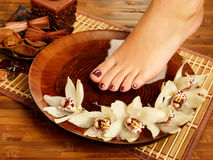 Female foot at spa salon on pedicure procedure stock photo