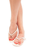 Female foot in thongs. On a white background Stock Image