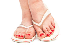 Female foot in a thongs. Female foot in thongs on a white background Stock Photo