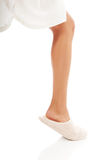 Female foot in white slippers Royalty Free Stock Image