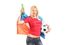 Female football fan with Dutch flag and a beer Stock Photo