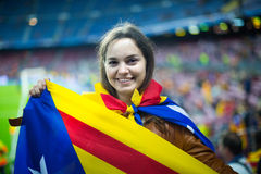 Female football fan with flag Stock Images