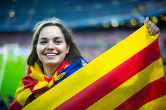 Female football fan with flag Royalty Free Stock Images