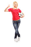 Female football fan giving a thumb up Stock Photography