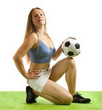 Female  football player with ball Stock Image
