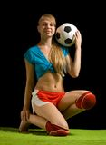 Female  football player with ball Royalty Free Stock Images