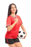 Female football player holding a ball and celebrating Stock Photography
