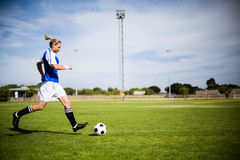 Female football player practicing soccer stock image