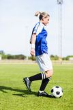 Female football player practicing soccer royalty free stock photos