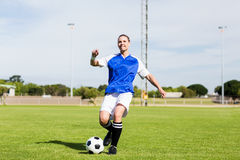 Female football player practicing soccer royalty free stock photography