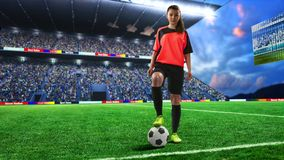 Female football player in red uniform on soccer field royalty free stock image