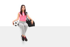 Female football professional sitting on a panel Royalty Free Stock Photos